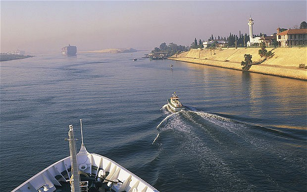 Suez Canal-Work on a parallel waterway to allow two-way traffic on Egypt's Suez Canal will be finished in time to allow ships to transit for a gala inauguration ceremony at the key trade route on Aug. 6